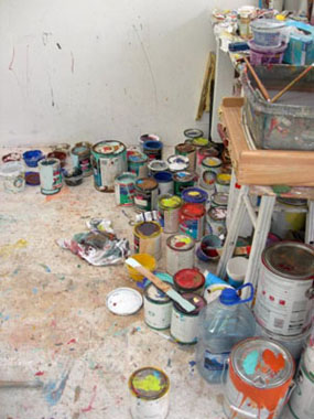 paint pots and brushes in Beth Amine's Studio